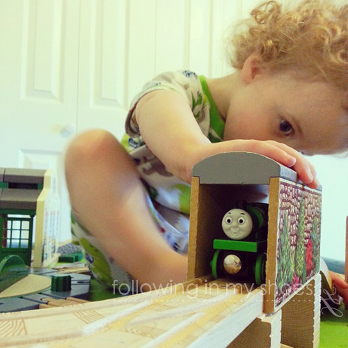 Baby Barney can't stay off the train table ... which is why I had The Husband glue and nail all of the buildings and track down.  One less thing to clean up!