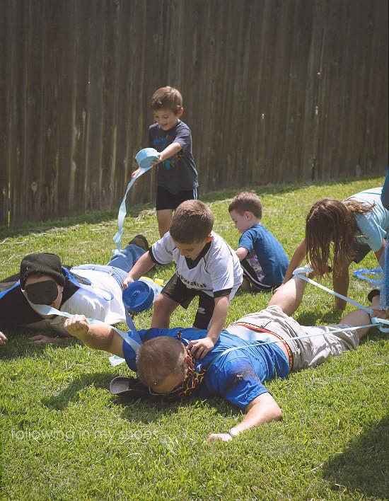 Fighting the Villains at a Preschool Superhero Party Game Idea