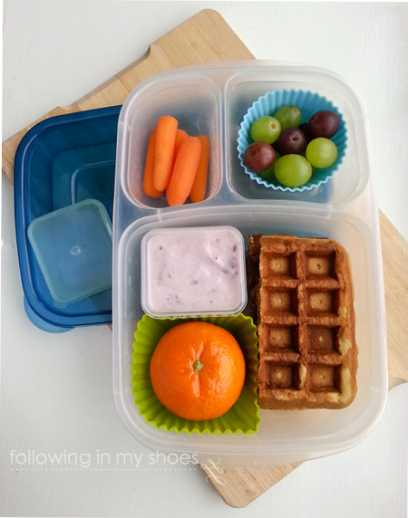 grainfree lunch idea: grainfree waffle almond butter and jelly sandwich, whole milk yogurt, orange, carrots, grapes