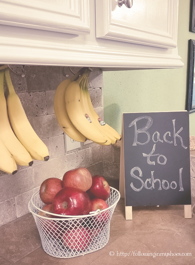 Bananas mounted UNDERNEATH a cabinet ... made from inexpensive backpack hooks.  GENIUS!!!